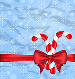 Christmas background with gift bow and sweet canes, snowflakes t