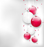 Christmas card with colorful glass balls and tinsel