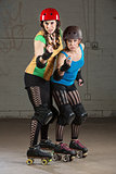 Roller Derby Skaters in Pointing Finger