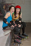 Laughing Female Roller Derby Skaters