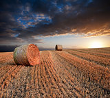 Beautiful golden hour hay bales sunset landscape