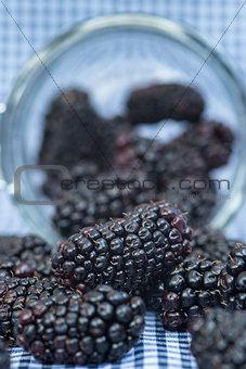 Fresh blackberries in glass jar