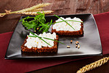 Dark bread slices with cottage cheese. Delicious healthy breakfa