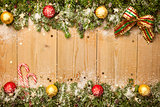 Christmas background with firtree, candies and baubles with snow