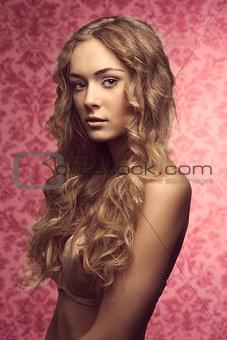 Blonde beautiful girl in beige lingerie vintage color