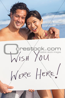 Asian Couple at Beach Wish You Were Here SIgn
