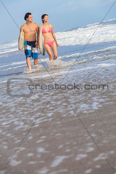 Asian Man Woman Surfers on Beach