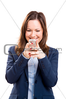 Business woman with a cellphone texting