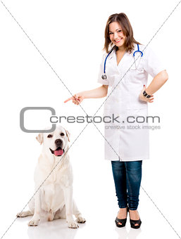 Beautiful young veterinary with a labrador dog, isolated over wh