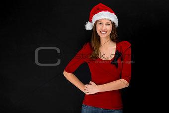 Beautiful woman wearing a santa hat