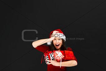 Beautiful woman holding christmas gifts