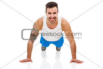 Athletic man making pushups