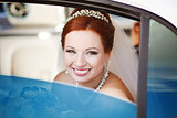 Lovely red hair bride in limo.