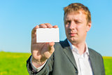 businessman showing blank business card