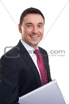 Portrait of smiling young businessman with laptop