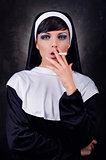 Smoking young nun