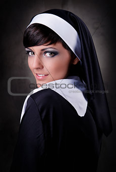 Portrait of young attractive nun