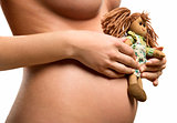 Pregnant woman holding a doll