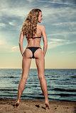 Sexy woman in black bikini