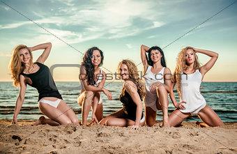 Five sexy ladies posing on the beach