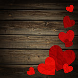 Hearts on the background of wood