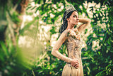 Gorgeous lady in evening dress and with tiara on a head