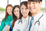 Professional medical doctor team standing in office