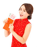 asian woman holding a red envelope with money