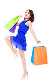 happy young fashion woman with shopping bags.