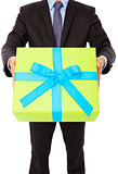 Businessman holding a gift. isolated on white background