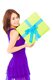 beautiful young woman holding a gift box