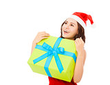 happy young woman holding a  christmas gift box