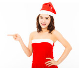 happy young woman wearing christmas suit with santa cap