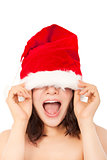 young christmas woman using santa cap to cover eyes.
