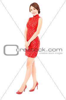 smiling asian young woman with cheongsam. isolated on white