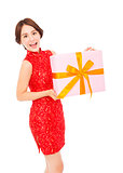 beautiful young asian woman holding a gift box