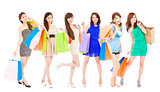 happy asian shopping women with color bags. isolated on white