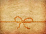Rope bow on paper