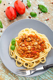 Spaghetti bolognese with basil leave