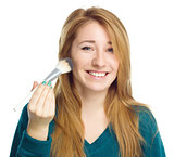 Girl is applying makeup  using brush
