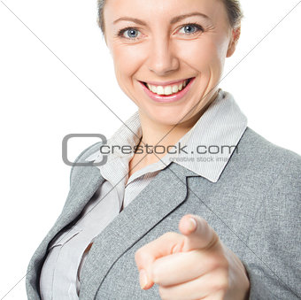 Portrait of young business woman pointing finger at viewer