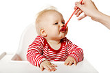Feeding. Baby Eating Dinner