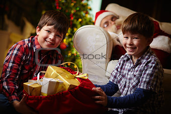 Boys with sack of presents