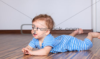 6 months old baby boy playing