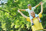 happy grandfather and child in park
