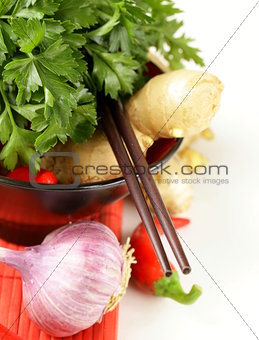 Asian style ingredients (ginger, chilli, coriander and garlic) in traditional utensils