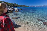 Woman Looking Over Beautiful Shoreline of Lake Tahoe.