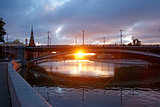 First rays of sunlight under the big stone bridge near Kremlin