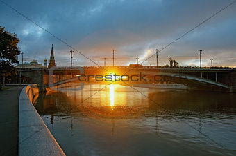 First rays of sunlight under the big stone bridge near Kremlin