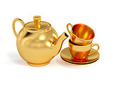 Golden cups and teapot isolated